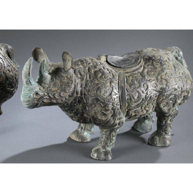 Chinese Chinese Bronze Rhinoceros Statues With Decorative Relief Pattern - a Pair For Sale - Image 3 of 10