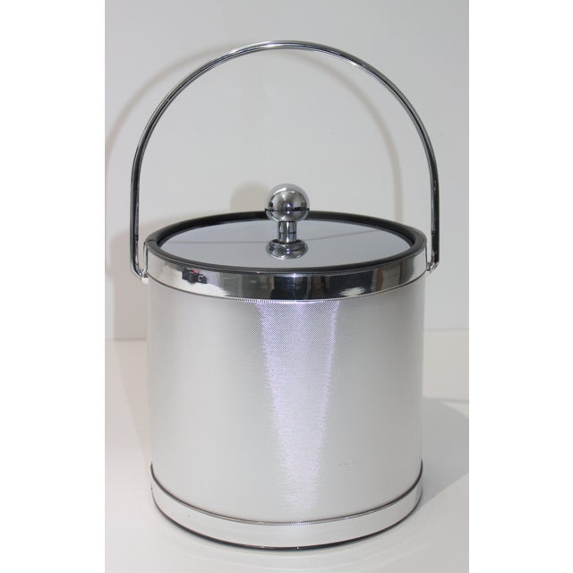 Vintage Ice Bucket Polished Stainless Steel and Mylar from a Palm Beach estate. 12 3/4 inches tall when handle is up up...
