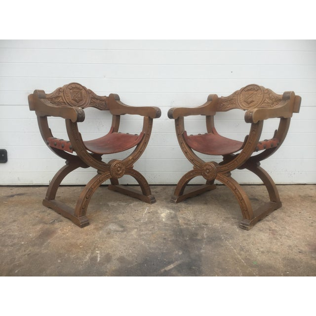This listing is for a pair of vintage Spanish Leather and wood chairs. Condition-good vintage condition with signs of wear...