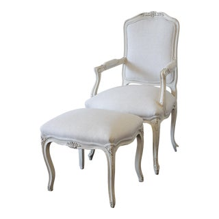 French Provincial Style Upholstered in Belgian Linen Chair and Ottoman For Sale