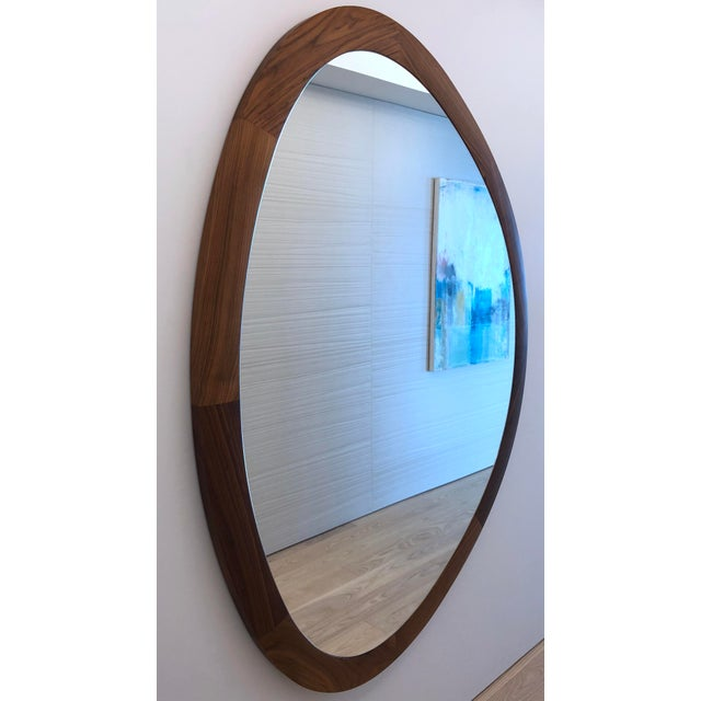 For sale is a Porada Giolo mirror hand made in Italy out of solid canaletta walnut. The mirror measures approximately 66...