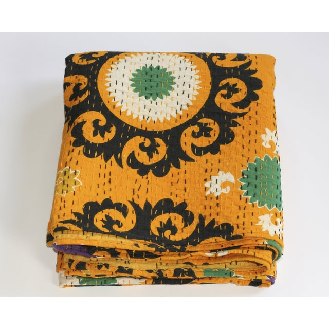 A 100% cotton, hand-stitched Kantha throw in a beautifully printed, vibrant Suzani pattern. This Full-sized throw blanket...