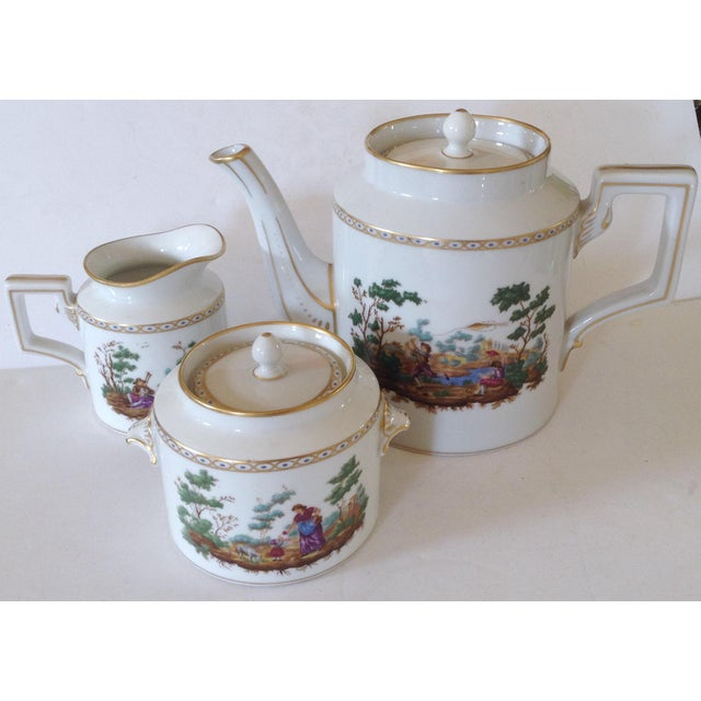Richard Ginori is one of the finest porcelain designers. This lovely tea set is fashioned with a different pastoral scene...