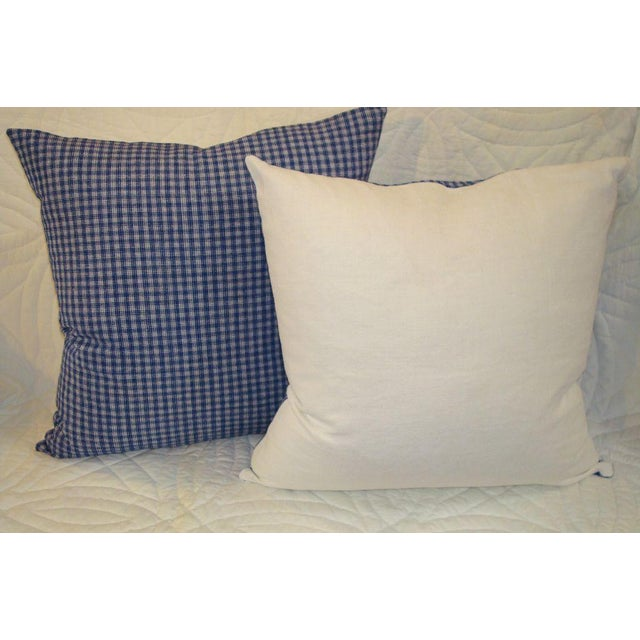 Linen plaid pillows in blue and white. Backing is white homespun linen. Zipper on bottom and down and feather inserts.