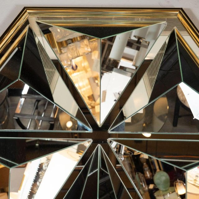 This graphic and sculptural Mid-Century Modern mirror was realized in the United States, circa 1970. It features a...