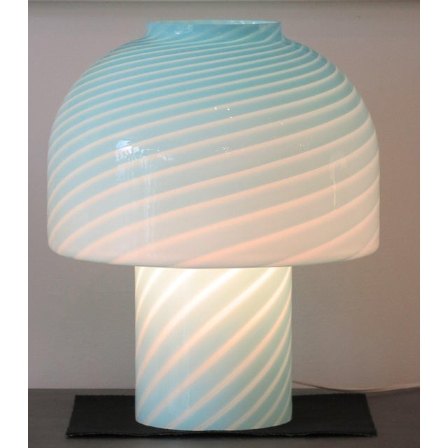 This is a pair of vintage Vetri murano glass blue table lamps. They are mushroom style lamps that could be used as bedside...