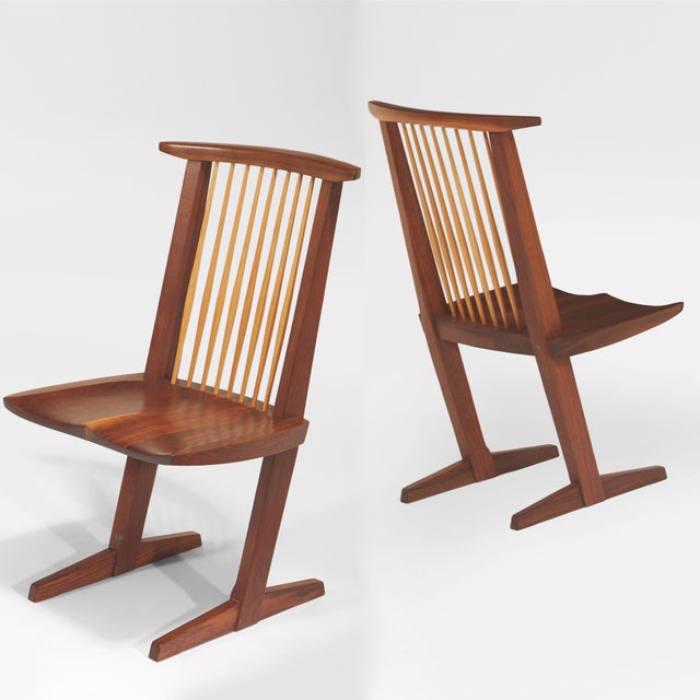 George Nakashima (1905–1990) An exceptional pair of Conoid chairs by master craftsman George Nakashima, among the last he...