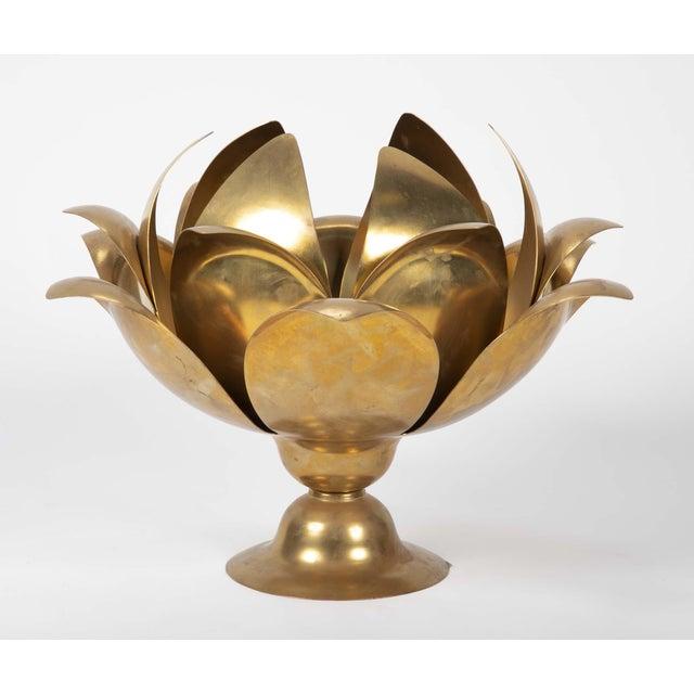 A contemporary brass incense burner. 19 H x 23 W x 27 D
