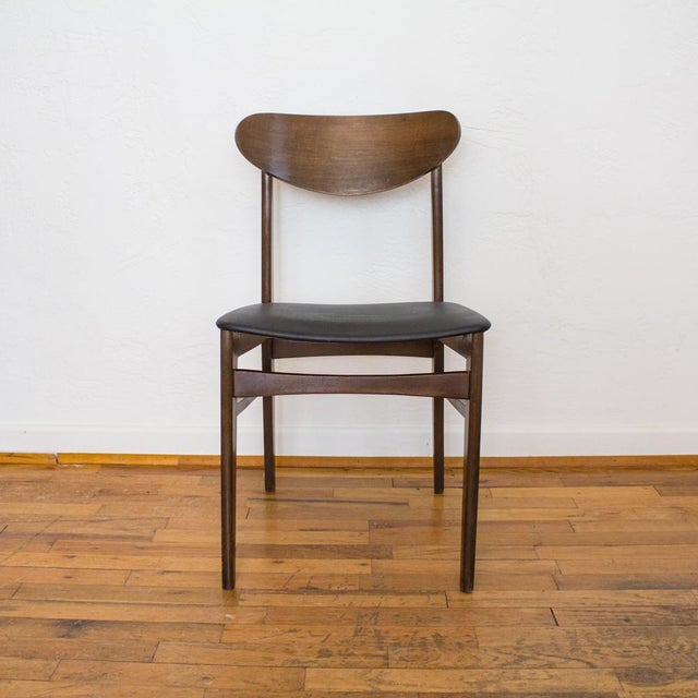 Mid century dining chair or side chair made in Yugoslavia features a bentwood seatback, dark brown wood stain and black...