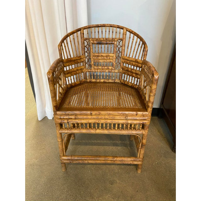 1940s Brighton Pavilion style burnished bamboo chair with curved Chinoiserie fretwork, cane seat.