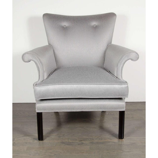 Superb pair of Hollywood occasional chairs with an accentuated scroll arm design, newly upholstered in a platinum...