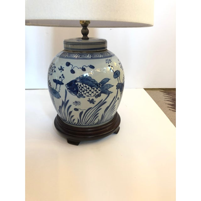 Elegant pair of blue and white canton style ginger jars mounted as lamps on dark wood stands and decorated beautifully...