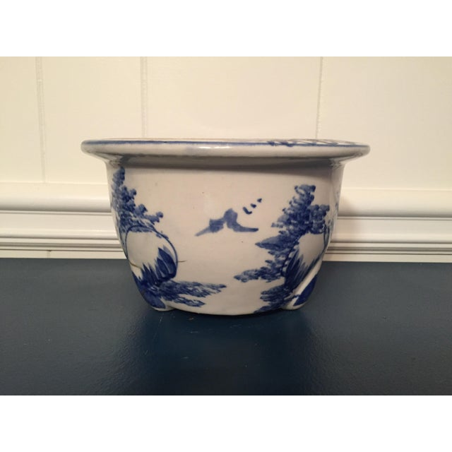 This is a blue & white plant pot. The piece is from the 1990s.