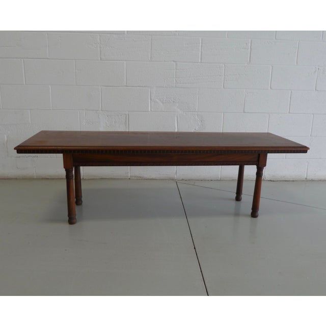 Beautiful vintage solid wood table with gorgeous carved accents. The wood has a lovely aged patina. Carved floral motif...