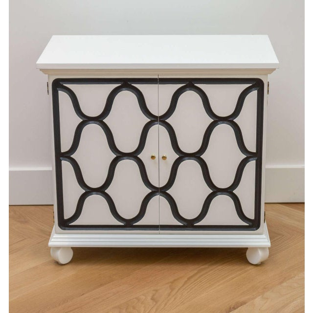 Lacquered Dorothy Draper two-door cabinet.