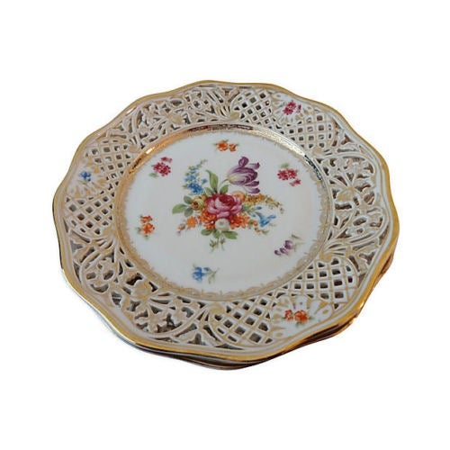 Superb Set of eight Dresden plates with reticulated borders and gilt-edged and scalloped rims. Plates have different...