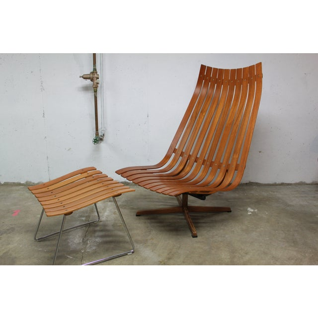 Gorgeous bent teak wood swiveling lounge with practically non-existent ottoman. Please note the minor repairs to the edges...