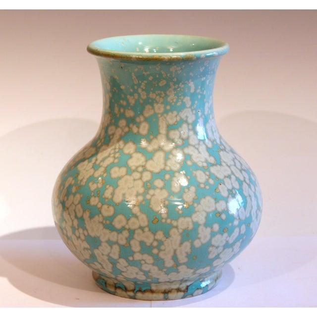 Old/antique Japanese studio vase in wide neck Hu form with fantastic crystalline glaze over a sky blue ground, circa 1930....