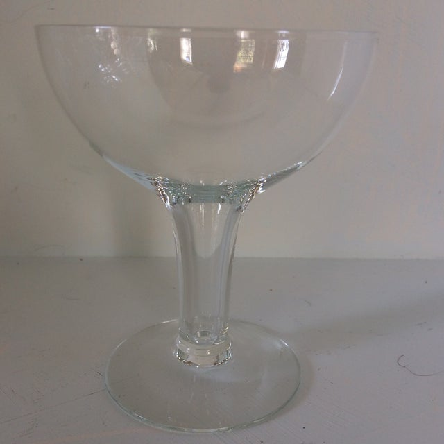The bowl area is 2.5 inches deep. Popular in Europe these crystal champagne glasses/coupes are called half sphere bowl...