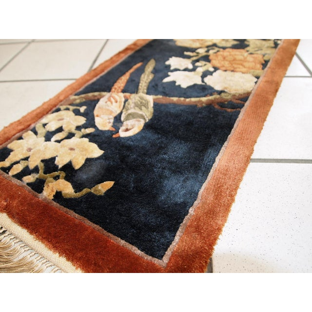 Handmade vintage silk Chinese rug in Art Deco style. The rug made in very dark night blue shade with the image of the tree...