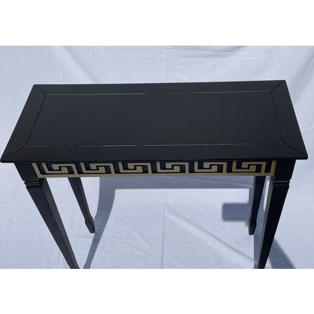 """This end table is a beautiful piece that was recently painted black with the carved """"Greek Key"""" decor being done in a..."""