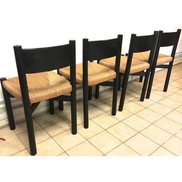 "Charlotte Perriand Set of Four Black Model ""Meribel"" Rush Chairs."