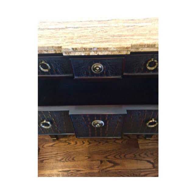 Empire inspired Transitional Chest with antique brass pulls and detail. The chest has a rich dark brown faux carved croc...