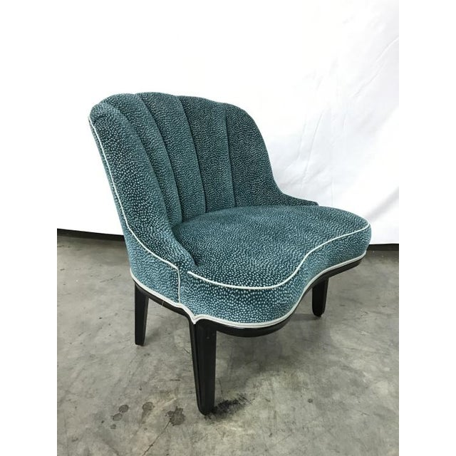 The Ede the Swede Chair is a first quality market sample that features a Green Fabric with a Jet Finish.