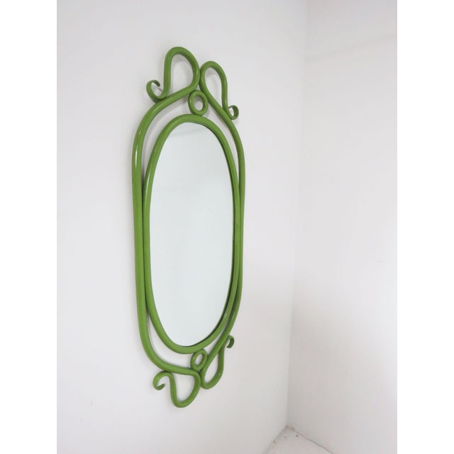 Midcentury bentwood wall mirror in what appears to be original avocado green lacquer in the style of Thonet of the Vienna...