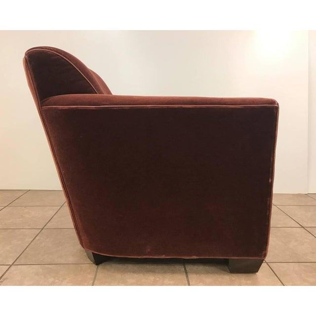 Art Deco style lounge chair. The chair has wood legs, leather trim and upholstered in mohair.