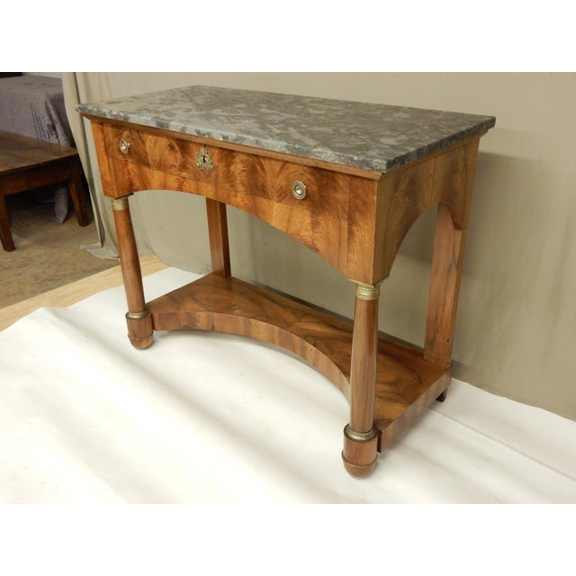 Fine early 19th century Italian Empire walnut console with original marble top. The console has one drawer and a lower shelf.