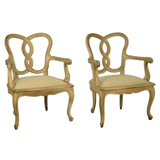Exceptional pair of painted Italian armchairs after a mid 18th century original Venetian design. Great sculptural quality.