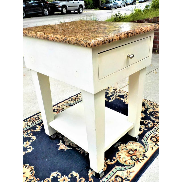 kitchen island or food preparation worktable all-white exterior color elegant granite marble top with rounded edges...
