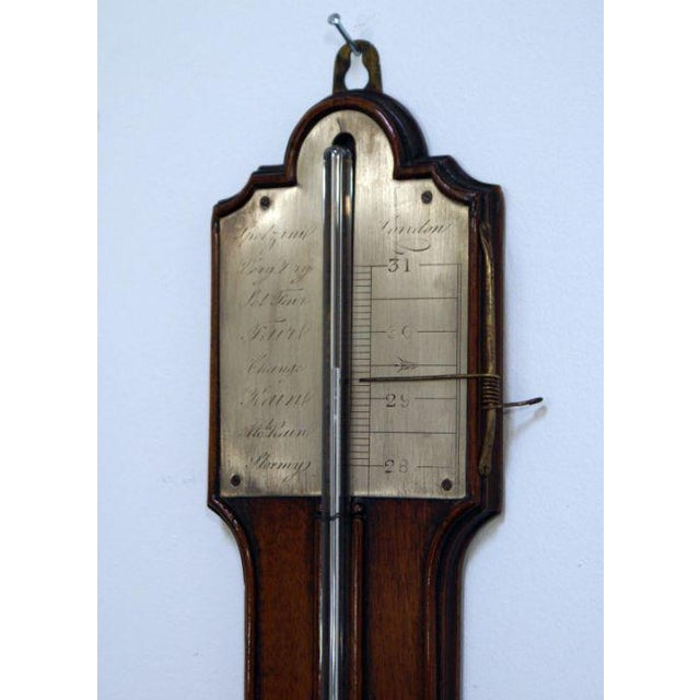 Nice Georgian stick barometer made in England during the first part of the 19th century. Mahogany with a satinwood medallion.