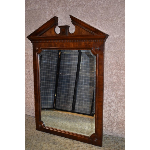 "Traditional Style Wall Mirror. Mahogany Frame. The color is dark red brown. The glass is bevelled. The measurements: 37""W..."