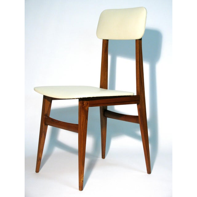 Italian modernist design side chair, in the manner of Gio Ponti, of walnut with original Lorica upholstery. The backrest...