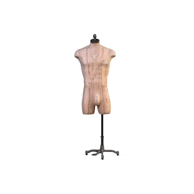 "This is a male mannequin on an adjustable 50-65""H stand. A perfect item to use for displaying outfits."