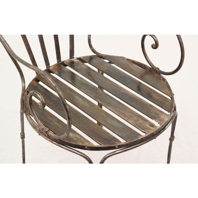 One of a pair of antique French polished steel chairs with later steel seats. Priced separately. These have an interesting...