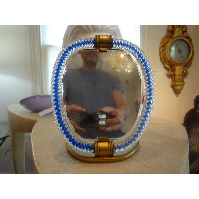 Gorgeous Venini inspired Murano glass and bronze vanity mirror or tabletop mirror. Featured Murano glass mirror is in a...