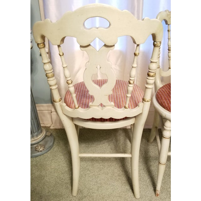 Pair of very cute petite French Country side chairs. Mint green painted wood with gold gilt detail. Upholstered padded seats.