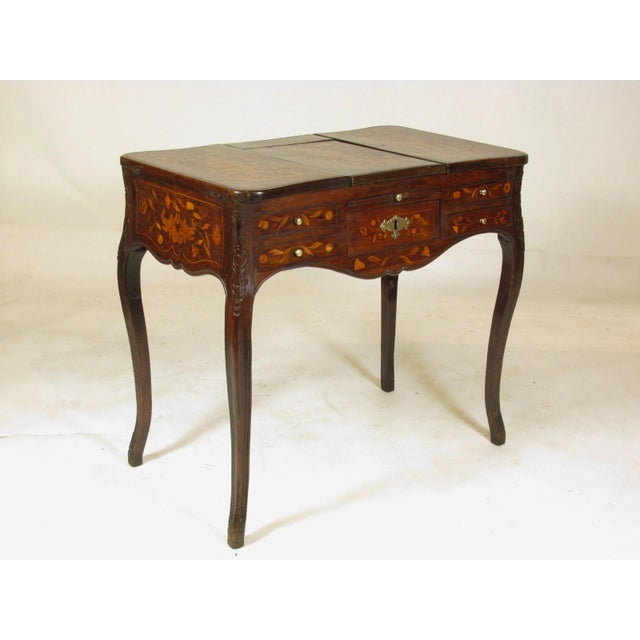An early 19th-C. French Louis XV style mahogany podruse (vanity) with elaborate marquetry detail throughout, a central...