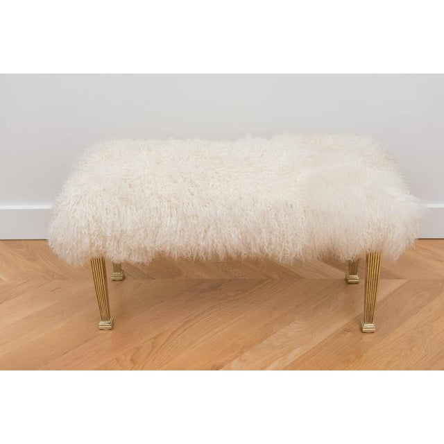Mongolian wool bench with polished reeded brass legs.