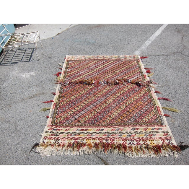 Offered is a vintage Turkish rug which can be used as a rug or tapestry. This multi colored rug will supply a happy dose...