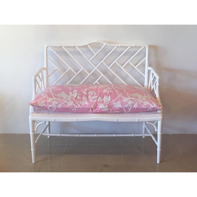 Vintage newly professionally lacquered in a white gloss faux bamboo Chinese Chippendale arm bench with caned seat and...