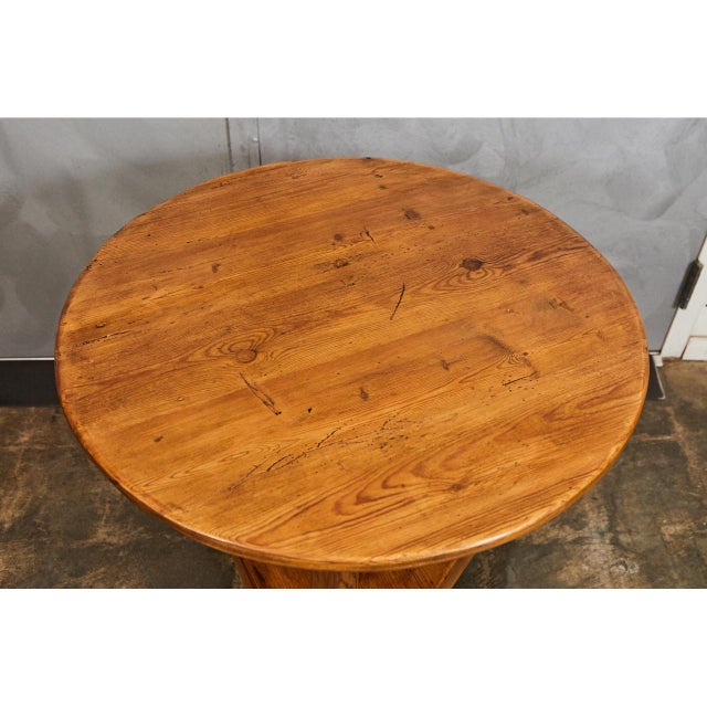 This nicely crafted cricket table has a nice color with original signs of age and use. The legs are three sided. These...