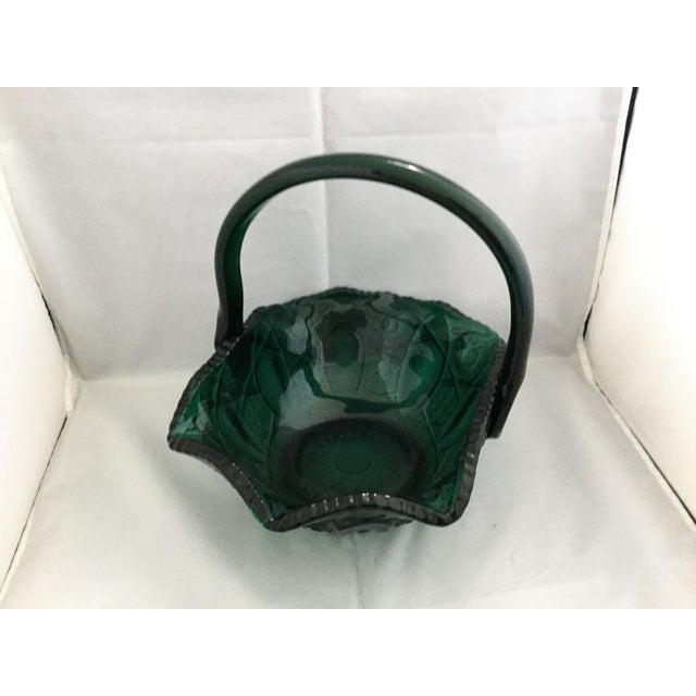 Green glass basket. Weighs 4lbs. 12ozs