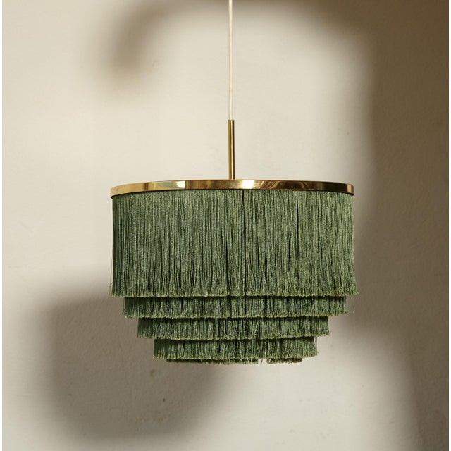 Hans-Agne Jakobsson brass and green silk fringed pendant lamp, Sweden, 1960s. Very good original condition, and a...