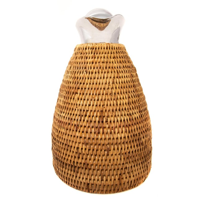 Artifacts Rattan hand woven glass line thermos provides the perfect accent to any table with a tight weave, durable...