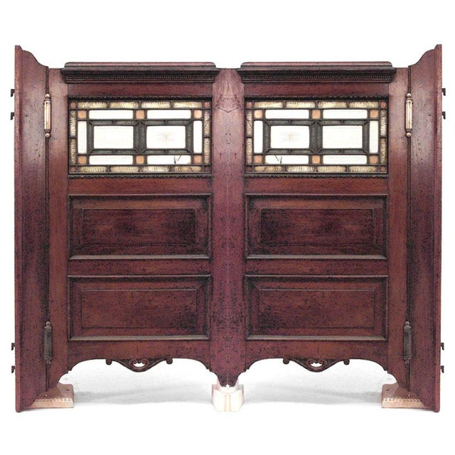 Pair of American Victorian mahogany swinging bar doors with leaded and colored glass panels.