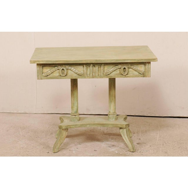 A Swedish 19th century Neoclassical painted wood Lindome style table. This antique Swedish console table features a richly...